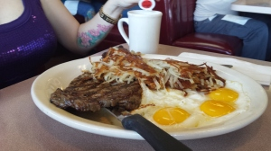 Rib eye Steak, over easy eggs, hash browns, coffee