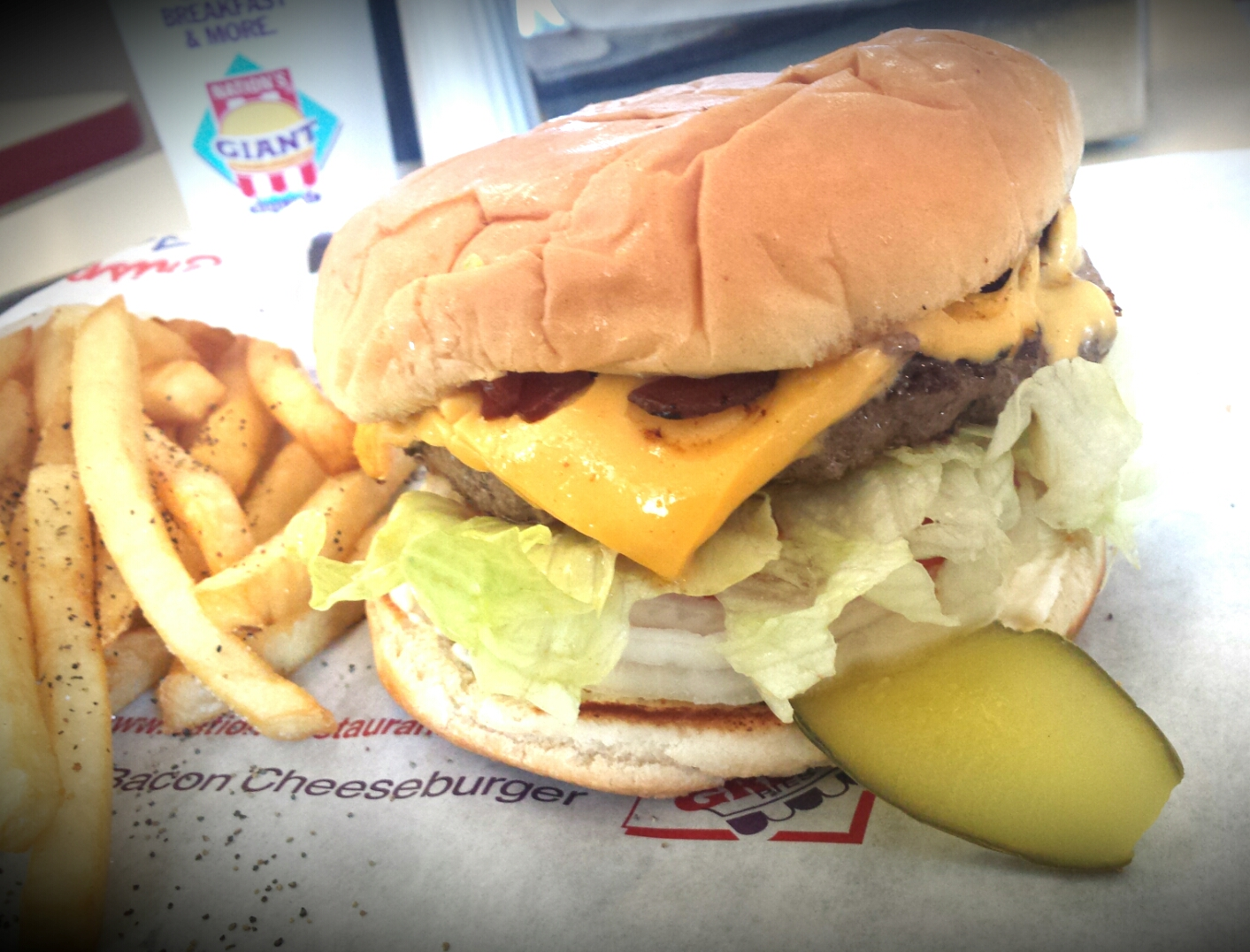 Bacon Cheeseburger, Lettuce, grilled onions,sliced pickles, tomatoes,cripsy french fries