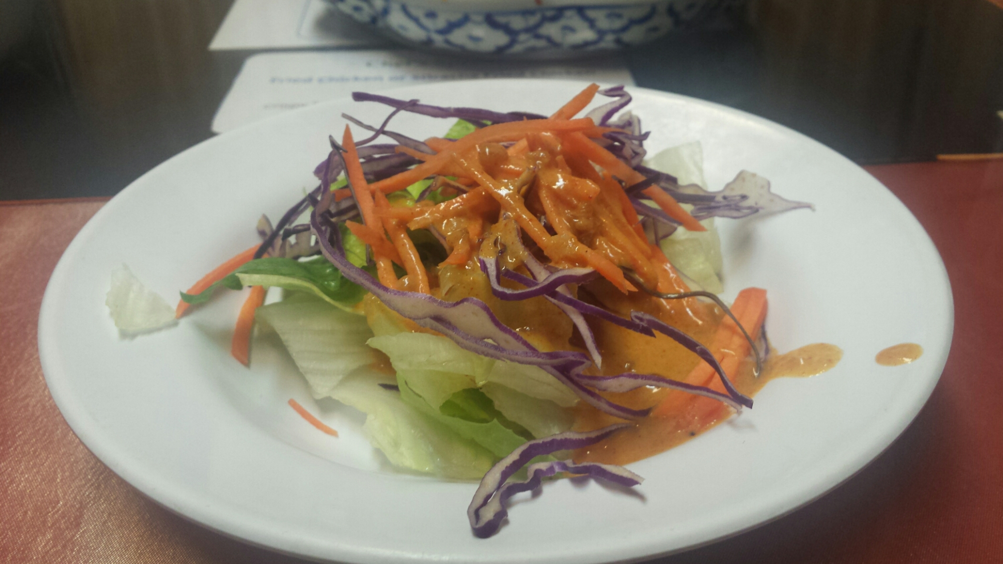 peanut sauce with shredded carrots, lettuce, and shredded cabbage