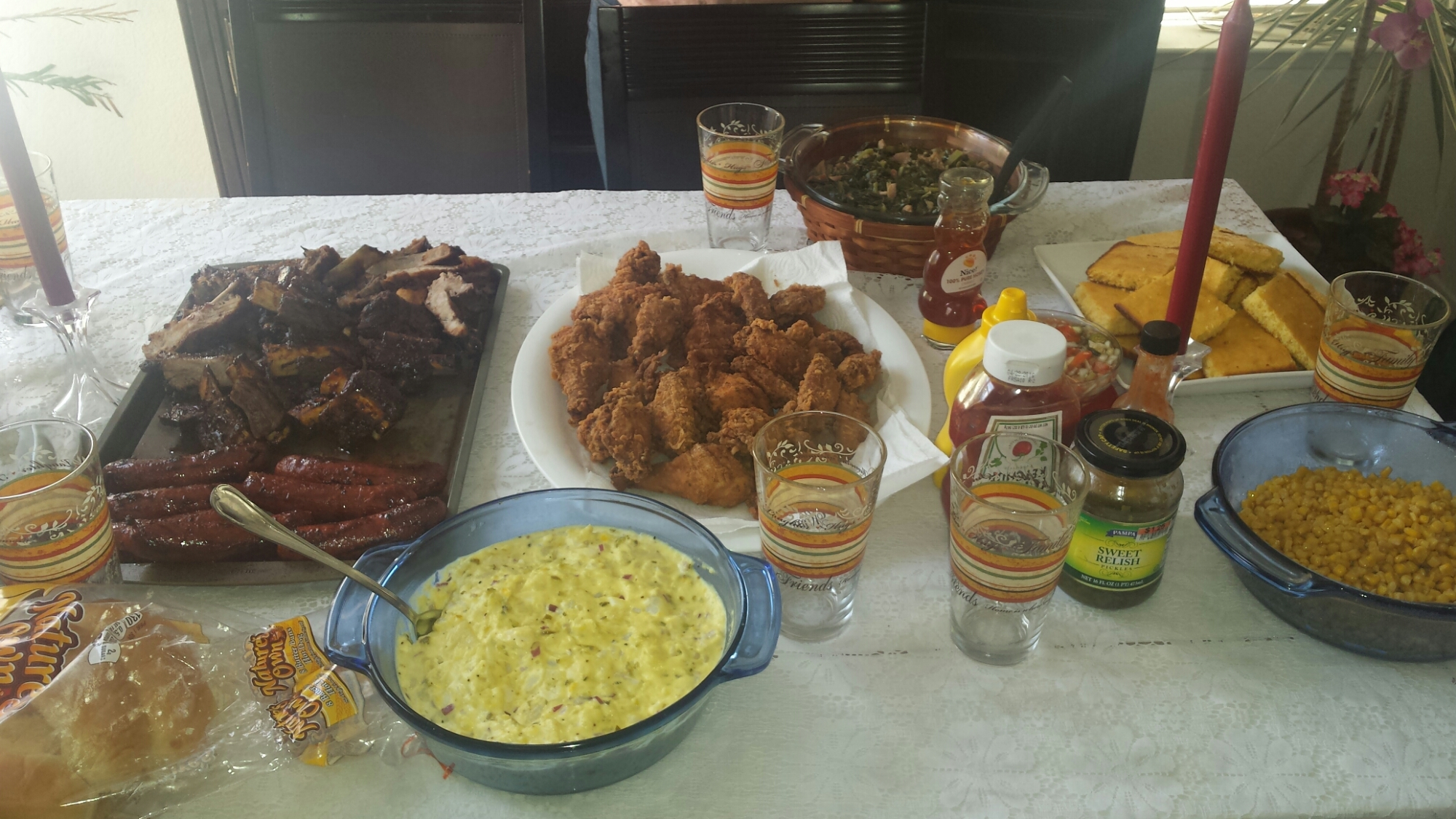 Pork ribs, beef ribs, potato salad, fried chicken, hotlinks collard greens