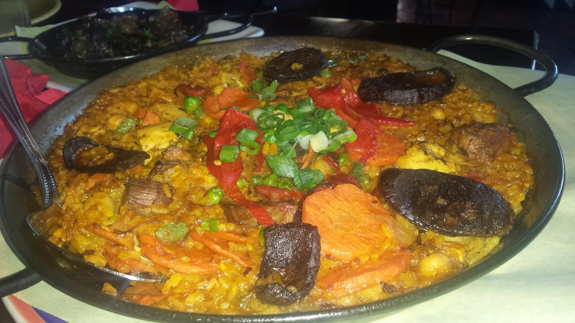 Paella Rustica – Lamb, chorizo, chicken, Morcilla, green beans, piquillo peppers and sofritto