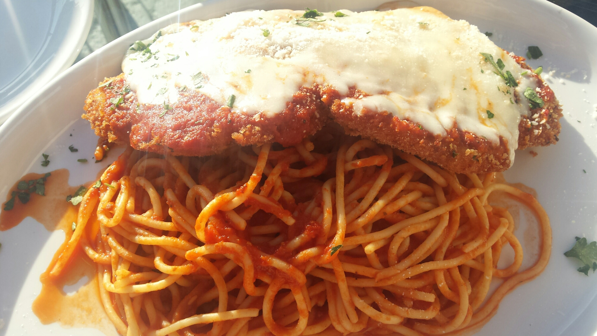 Pollo Parmigiana- Mary's organic chicken breast, lightly breaded, topped with meltedmozzarella, San Marzano marinara, served over spaghetti pomodoro