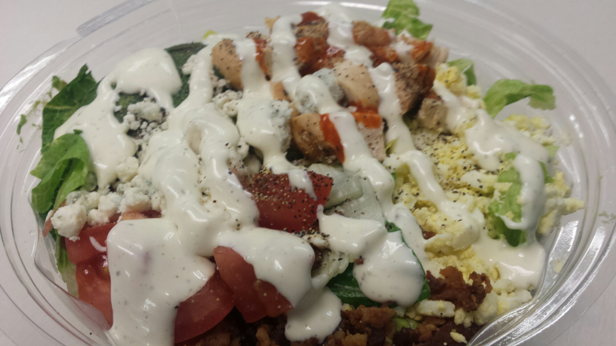 Cobb Salad - bacon, avocado, boiled eggs, ranch dressing, blue cheese, tomatoes