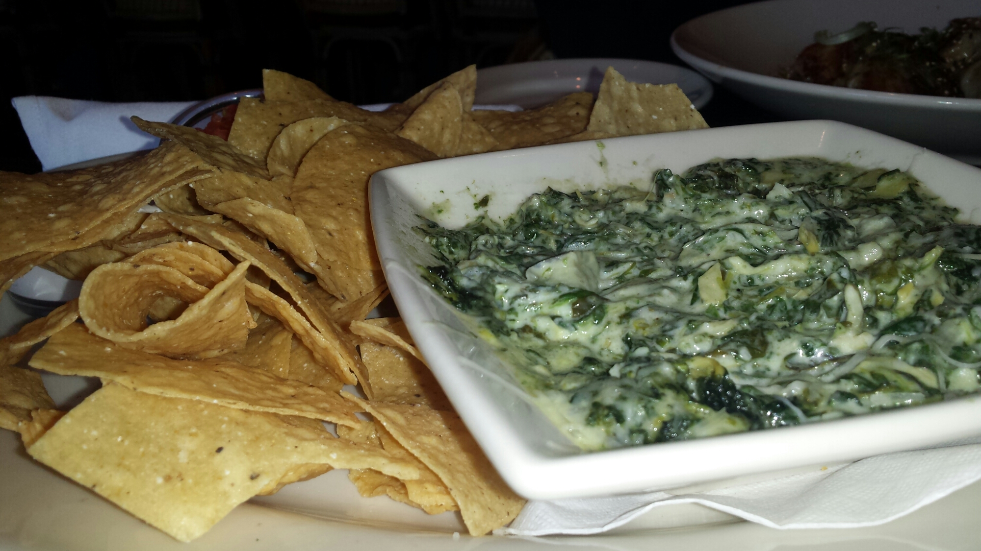 Hot Spinach and Cheese Dip- Spinach, Artichoke Hearts, Shallots, Garlic and a Mixture of Cheeses. Served Bubbly Hot with Tortilla Chips and Salsa.