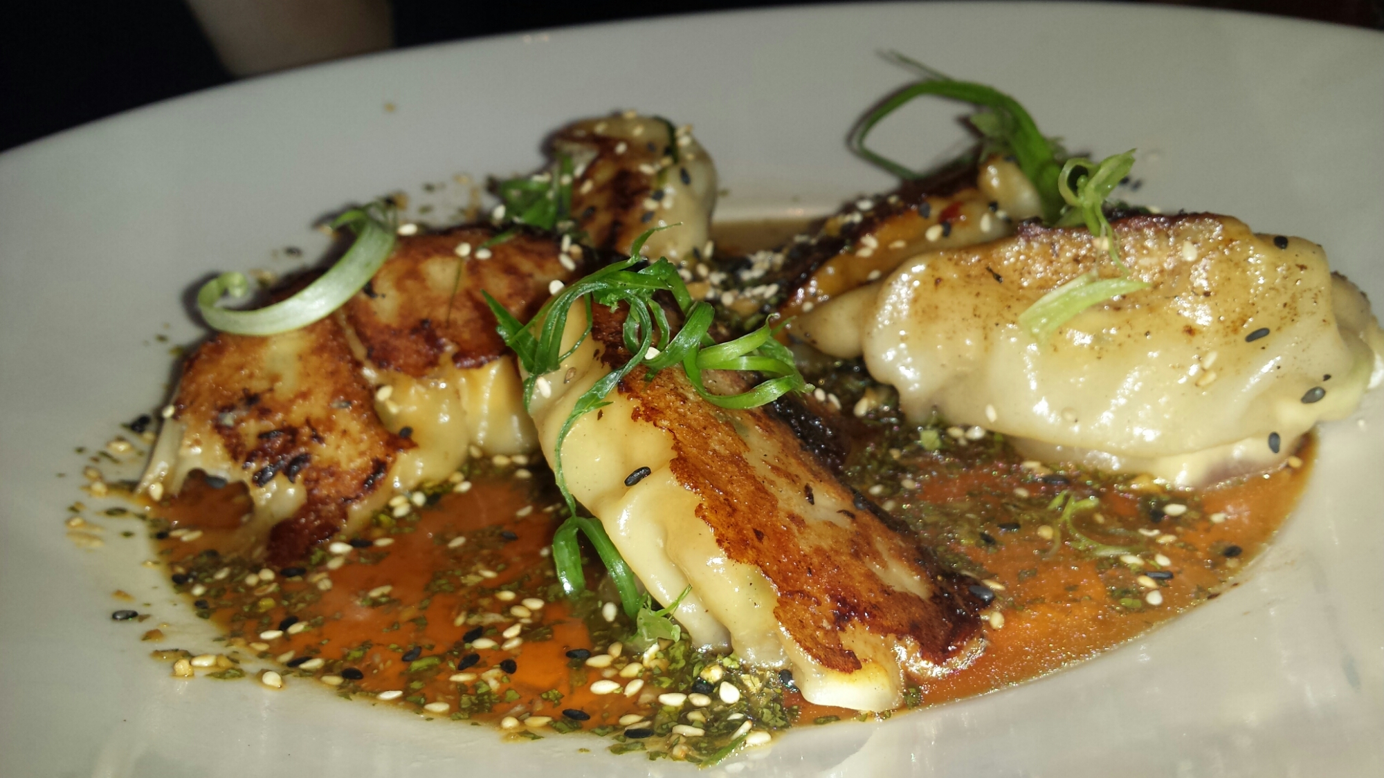 Chicken Pot Stickers - Oriental Dumplings Pan-Fried in the Classic Tradition. Served with our Soy-Ginger Sesame Sauce
