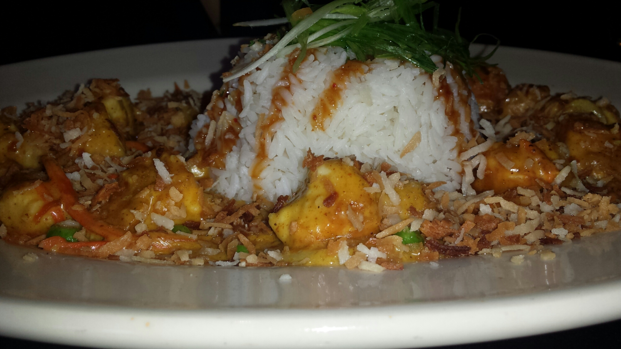 Bang Bang Chicken and Shrimp - A Spicy Thai Dish with the Flavors of Curry, Peanut, Chile and Coconut. Sautéed with Vegetables and Served over Steamed White Rice.