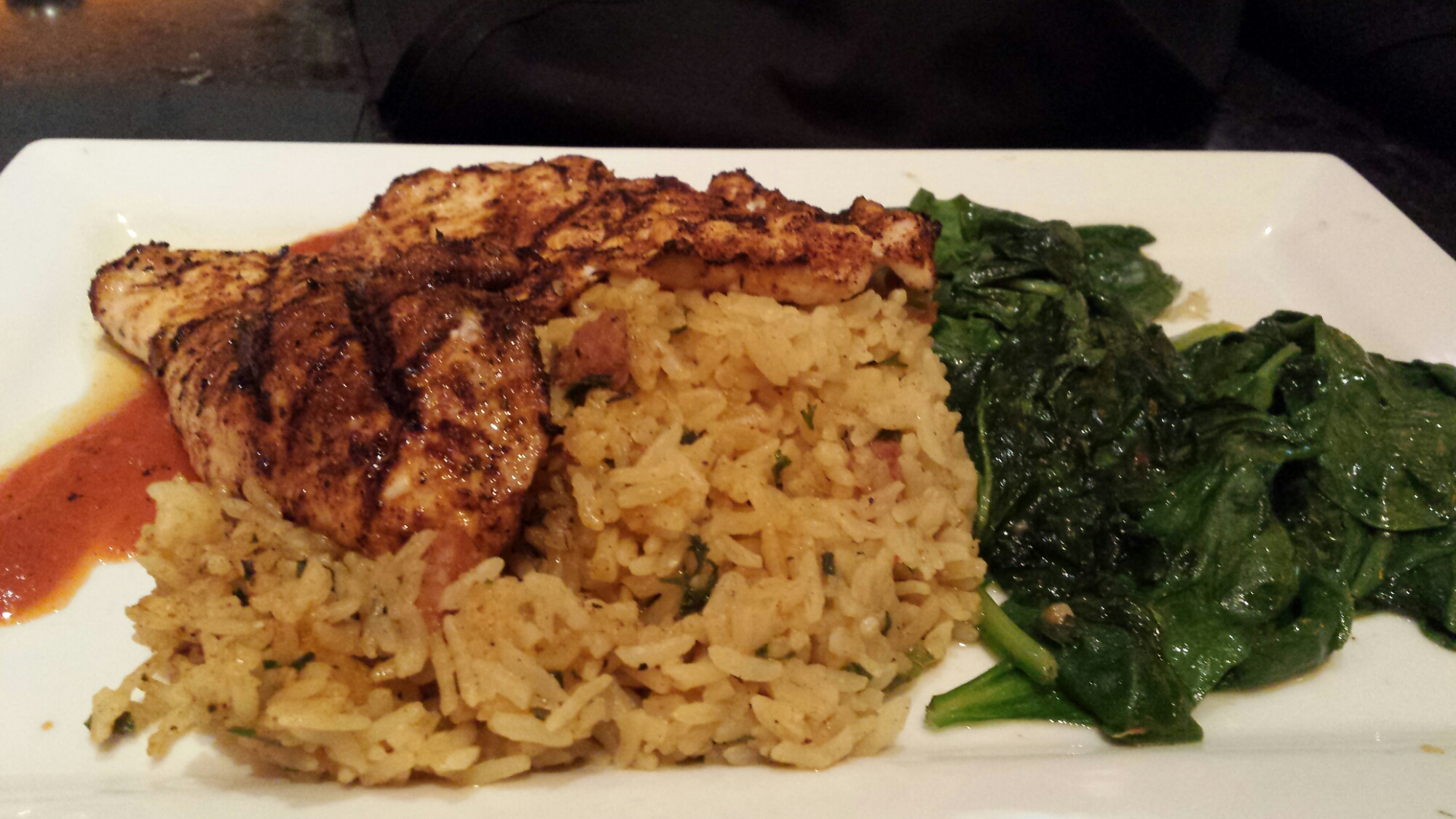 Grilled chicken breast · Cajun spice · Bourbon street rice with Andouille sausage · sautéed spinach