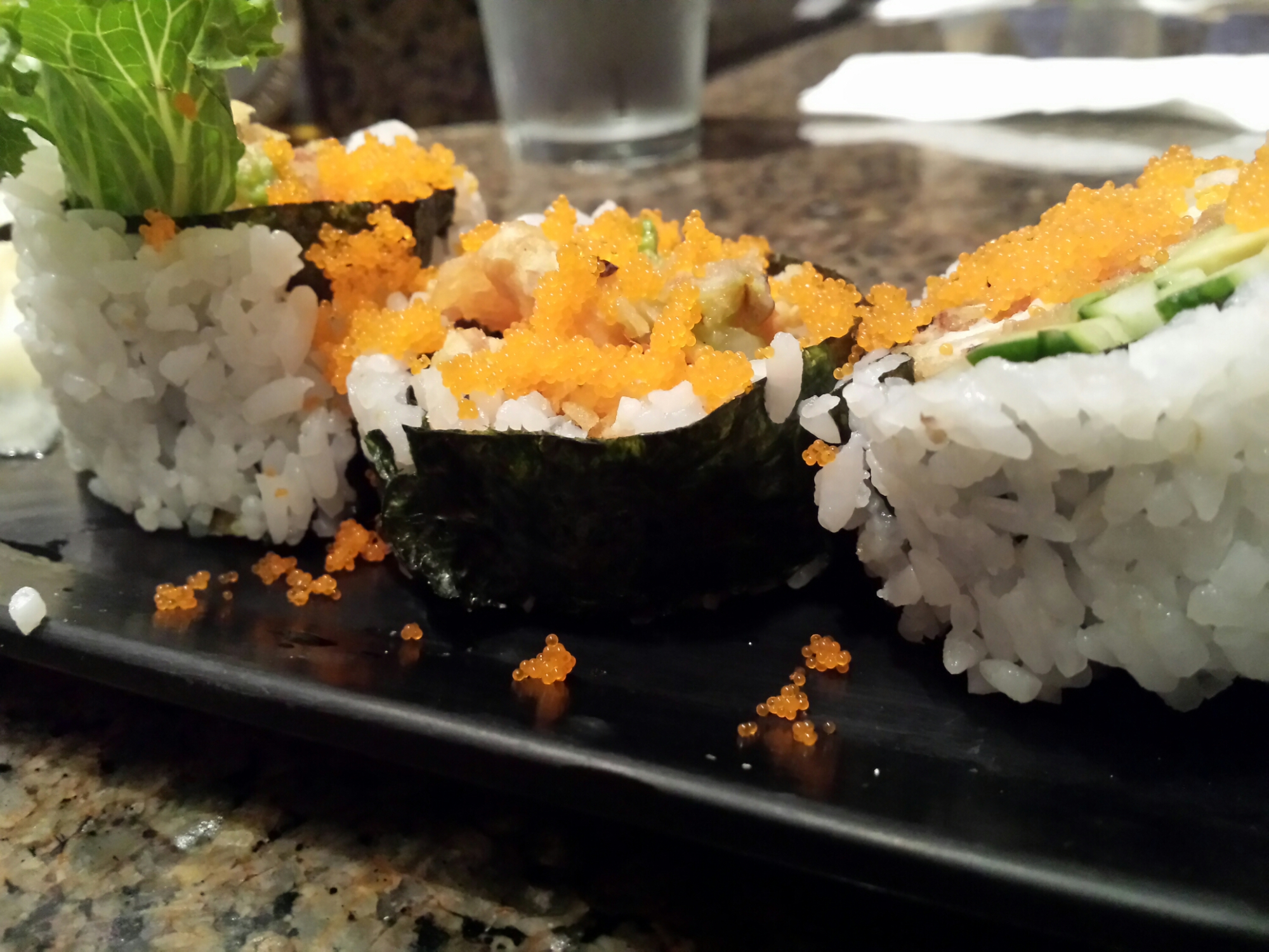 Spider Roll - Soft shell crab, avocado, cucumber, masago